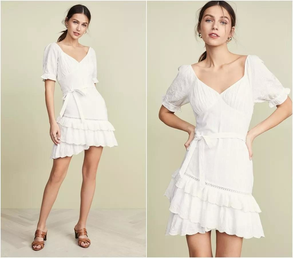 detailed white dress with puff sleeves and flounced hem